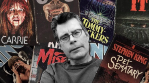 Image of Stephen King in front of book covers.